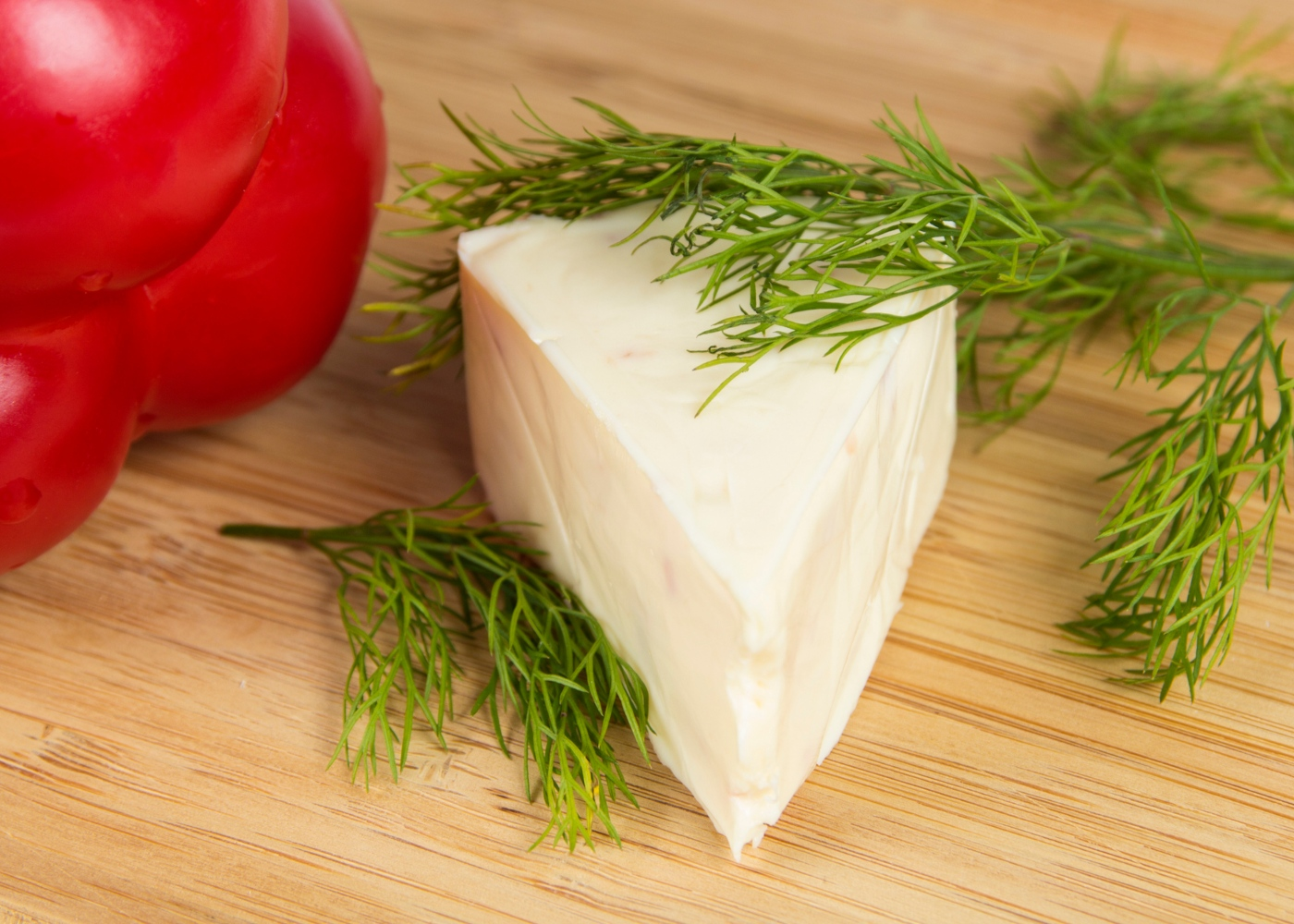 Triângulo de queijo fundido